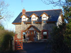Photo of a stone cottage converted into a three bedroom residence, built by Atfar Construction